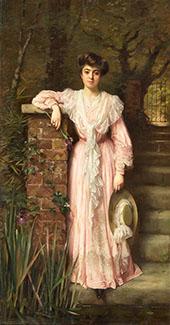 Portrait of a Lady in a Garden Wearing a Pink Dress Holding an Iris By Thomas Benjamin Kennington