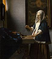 A Woman Holding a Balance c1662 By Johannes Vermeer