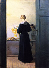 Young Woman Arranging Flowers By Anna Ancher